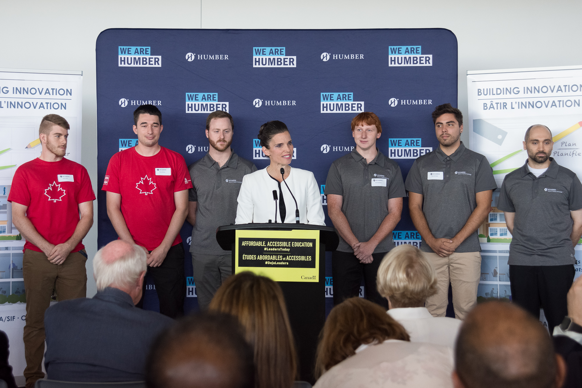 Humber receives 216 million from federal government humber today woman stands at podium in front of humber college banner 1betcityfo Images